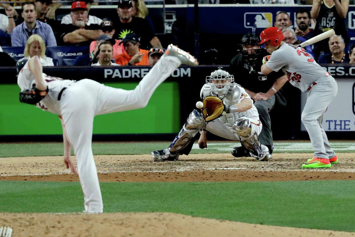 National League's Aledmys Diaz, of the St. Louis Cardinals, is struck out looking by American League's Will Harris, of the Houston Astros, during the eighth inning of the MLB baseball All-Star Game, Tuesday, July 12, 2016, in San Diego. (AP Photo/Jae C. Hong)