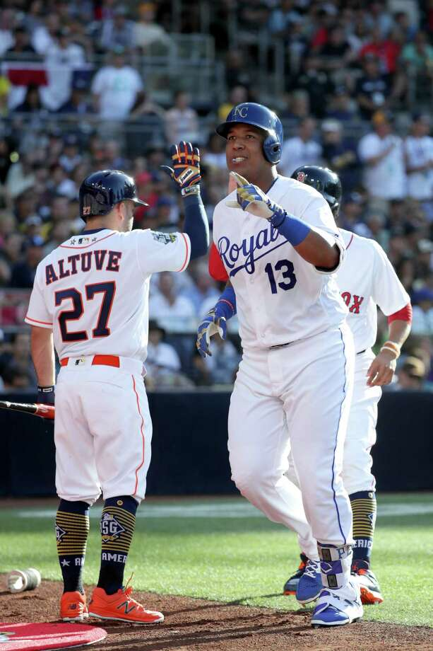 Jose Altuve greets close friend Salvador Perez after the Royals catcher homered to give the American League the lead in the second inning. Photo: Sean M. Haffey, Staff / 2016 Getty Images