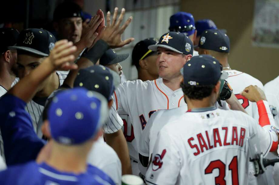 The Astros' Will Harris, center, is a hit in the AL dugout after escaping a bases-loaded jam in the eighth inning. Photo: Sean M. Haffey, Staff / 2016 Getty Images