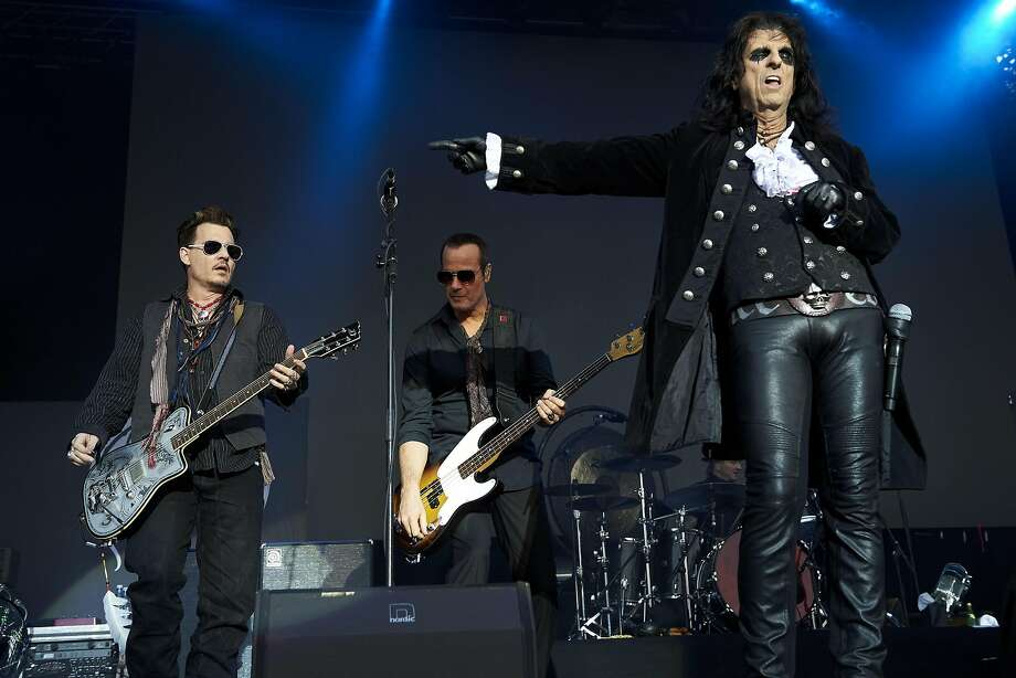 "Johnny Depp, left, and Alice Cooper, right, performs with their band ""Hollywood Vampires"", Wednesday June 1, 2016, at the music venue in the former Horsens State Prison, in Horsens, Jutland, Denmark. (Claus Bonnerup/Polfoto via AP) DENMARK OUT Photo: Claus Bonnerup, Associated Press"