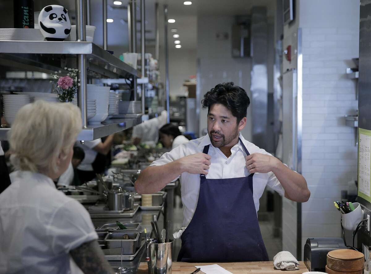 Chef Brandon Jew, right, chats with Amanda Hallquist as he preps dinner service at the restaurant in San Francisco, Calif., on Tuesday, July 12, 2016.