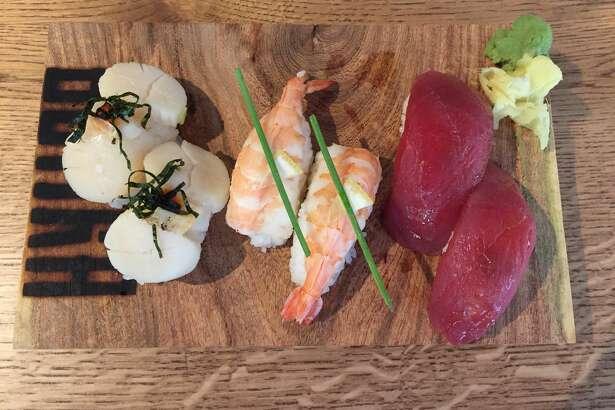 This nigiri trio at Botika features (from left) scallops, shrimp and tuna.
