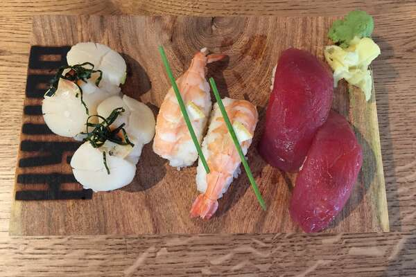 This nigiri trio at Botika features (from left) scallops, shrimp and tuna.