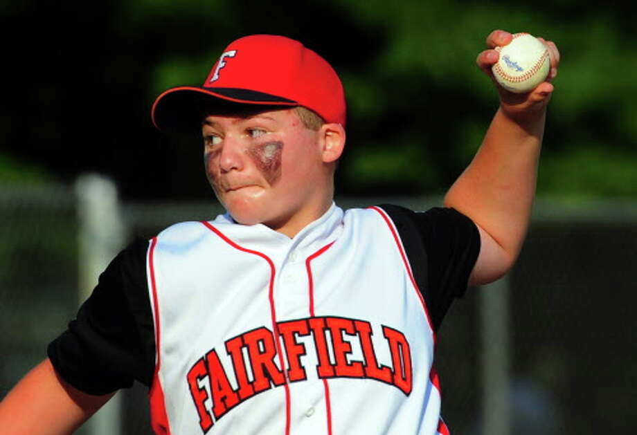 Fairfield American picther Richie Kerstetter fires toward the plate during District 2 Little League tournament action on Tuesday against Trumbull American at Unity Park in Trumbull. Kerstetter threw a no-hitter and struck out 15 as Fairfield won 7-0 to advance into Saturday's championship game. Photo: Christian Abraham / Hearst Connecticut Media / Connecticut Post
