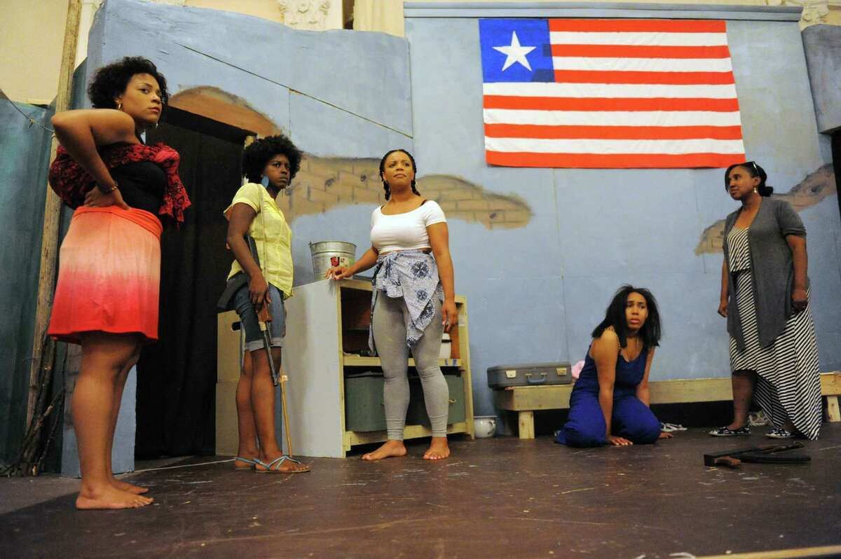 Actors, left to right, Angelique Power, Daniele Collin, Adrian Coleman, Kendra Neal and Michelle Gordon during rehearsal for the play