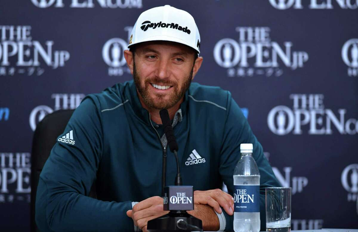 US golfer Dustin Johnson smiles as he speaks to members of the media at a press conference on July 13, 2016, ahead of the 2016 British Open Golf Championship at Royal Troon in Scotland. The 2016 British Open begins on July 14, 2016.