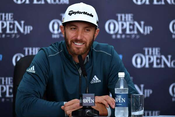 US golfer Dustin Johnson smiles as he speaks to members of the media at a press conference on July 13, 2016, ahead of the 2016 British Open Golf Championship at Royal Troon in Scotland. The 2016 British Open begins on July 14, 2016. / AFP PHOTO / Ben STANSALL / RESTRICTED TO EDITORIAL USEBEN STANSALL/AFP/Getty Images
