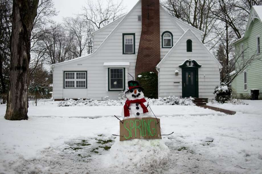This snow man says it all — people are ready for spring to really begin! Photo: Daily News File Photo