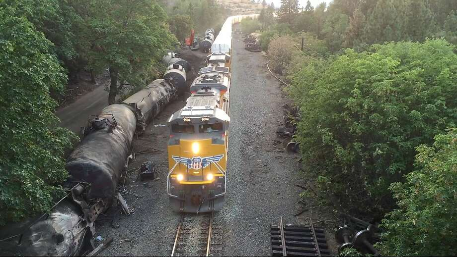 Crumpled oil tankers lie beside railroad tracks after a fiery train derailment last month that prompted evacuations from the tiny Columbia River Gorge town of Mosier, Ore. Photo: Brent Foster, Associated Press