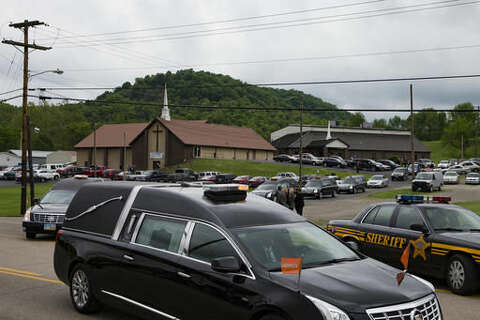 Funeral for 6 slain family members held in southern Ohio