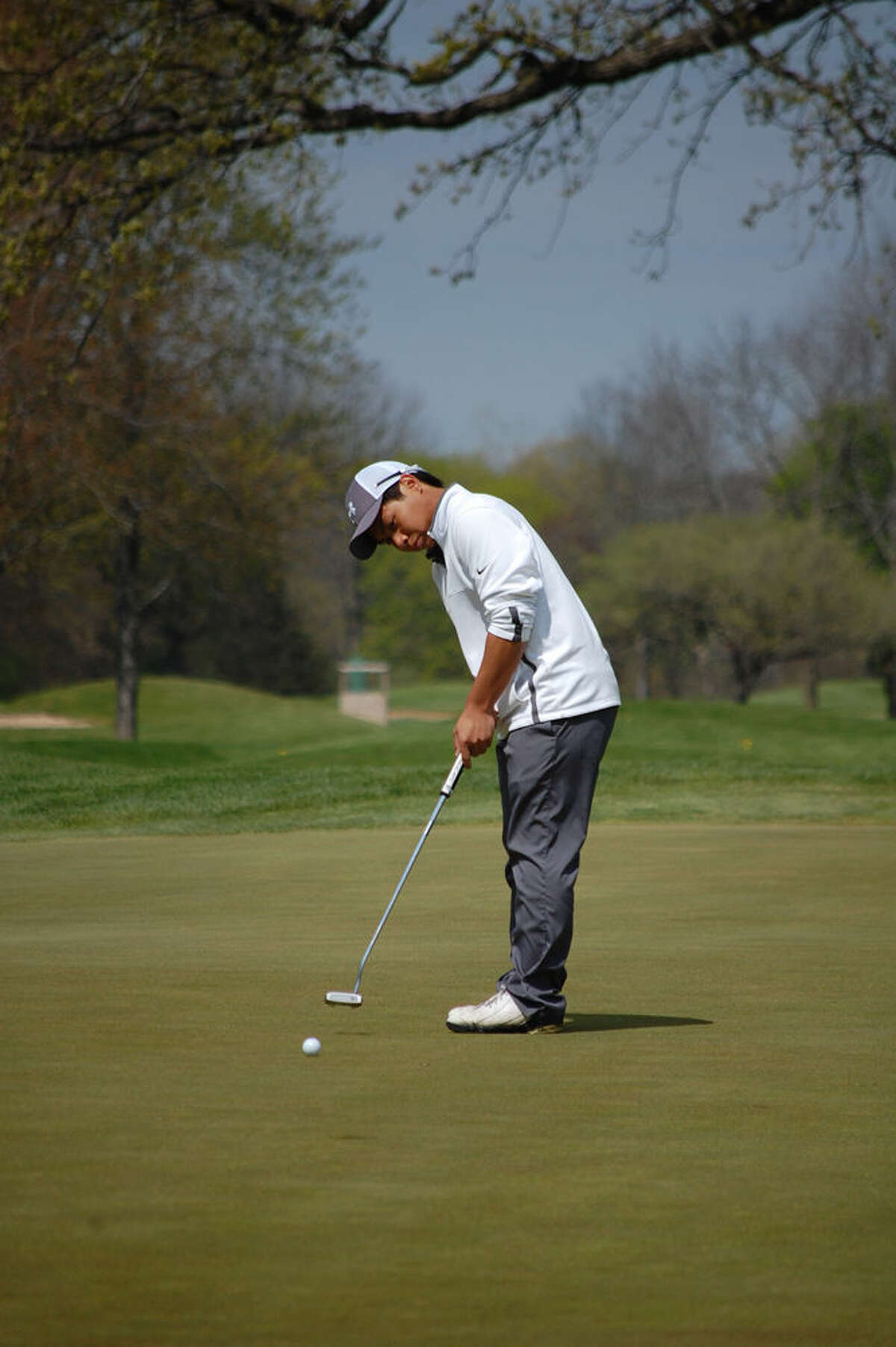 Midland High's Top Kamnark hopes to lead the Chemics golf team to a top five finish in the Division 1 state finals on Friday and Saturday.