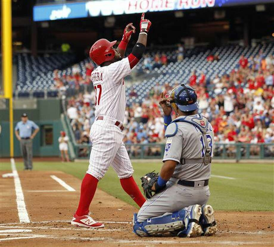 Philadelphia Phillies' Odubel Herrera, left, points skyward as he walks past Kansas City Royals catcher Salvador Perez after hitting a solo home run during the first inning of a baseball game Friday, July 1, 2016, in Philadelphia. (AP Photo/Tom Mihalek) Photo: Tom Mihalek