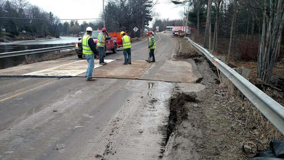 This file photo from the Midland County Road Commission Facebook page shows the temporary fix of plate steel on West River Road at the Black Creek. The road is expected to reopen to two-way traffic by the end of the day Thursday.