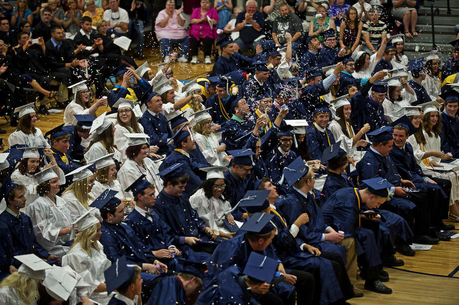 One hundred twenty students walked across the stage at Meridian Public Schools commencement ceremony last week, but only 40 of them took home a diploma. That's because the other 80 students, two-thirds of the graduating class, have chosen to participate in Meridian's fifth year program for a free first year of college. Photo: Erin Kirkland | Midland Daily News