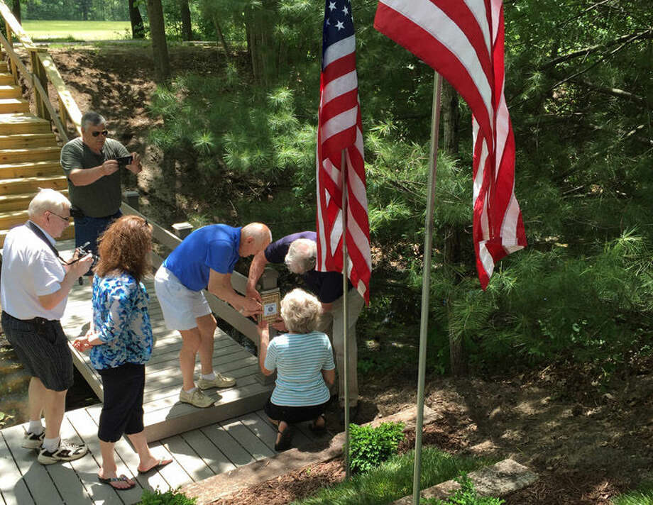 A memorial plaque is attached to the bridge at the West Midland Family Center. The dedicated bridge represents more than a year of work and a collaboration between Kiwassee Kiwanis and West Midland Family Center. Photo: Photo Provided