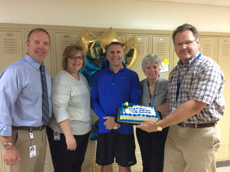 Pictured are Midland High Principal Jeff Jaster, Registrar Chev Gardner, Marty Hollenbeck, Administrative Assistant Lori Kennemer and Vice Principal Bob Scurfield .