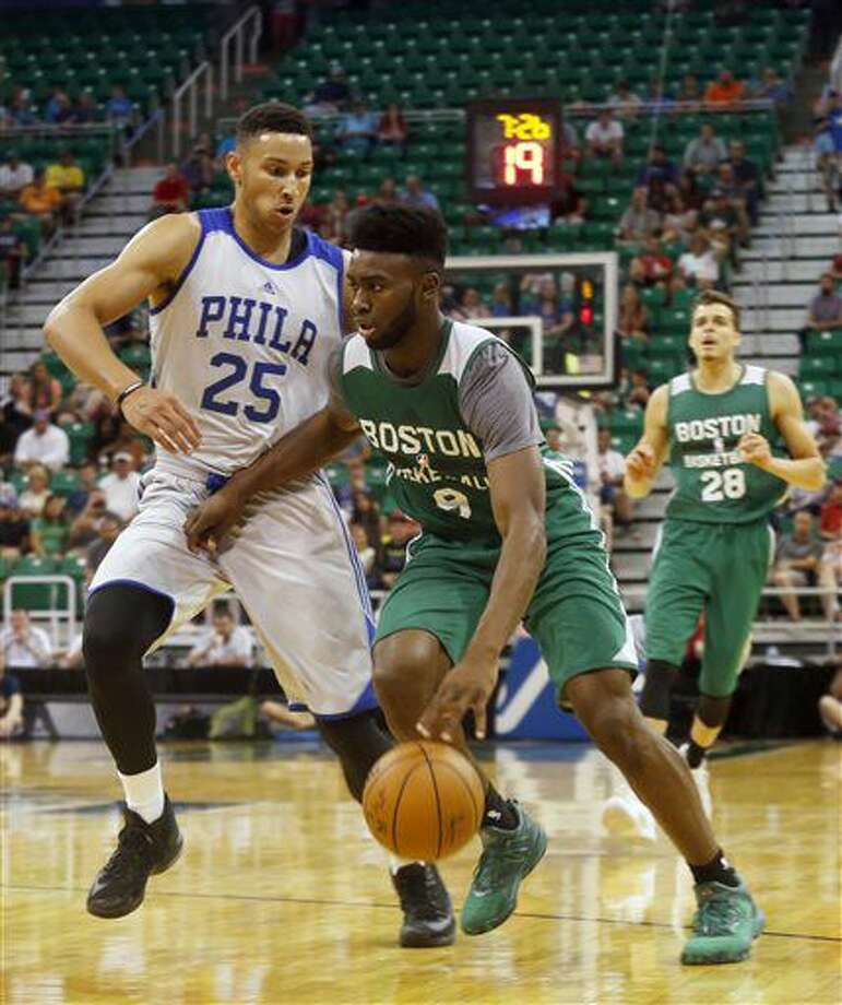 Philadelphia 76ers' Ben Simmons, left, defends as Boston Celtics' Jaylen Brown (9) drives the basket during the second half of an NBA Summer League basketball game Monday, July 4, 2016, in Salt Lake City. (AP Photo/Kim Raff) Photo: Kim Raff