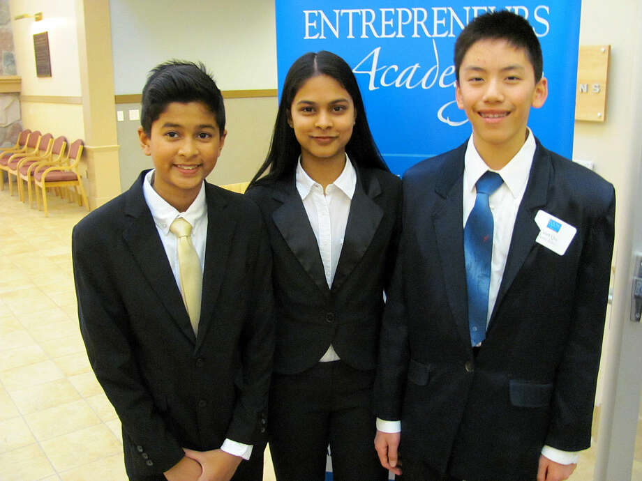 Jefferson Middle School students, from left, Debanshu Kanungo, Debasmita Kanungo and Caleb Qiu, principals of Ensure Robo Plus, which encourages STEM education by teaching the building and programming of robots, are among students who will be presenting at the YEA! Trade Show on Wednesday, May 18, from 5 to 7 p.m. in conjunction with the Chamber Connection at Garber Chevrolet, located at 1700 N. Saginaw Road. Photo: John Kennett | Jkennett@mdn.net