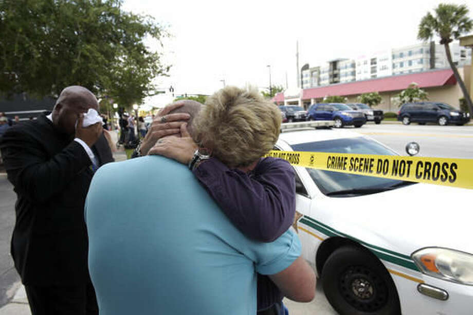 Terry DeCarlo, executive director of the LGBT Center of Central Florida, center, is comforted by Orlando City Commissioner Patty Sheehan, right, after a shooting involving multiple fatalities at a nightclub in Orlando, Fla., early Sunday. Photo: Phelan M. Ebenhack | AP Photo