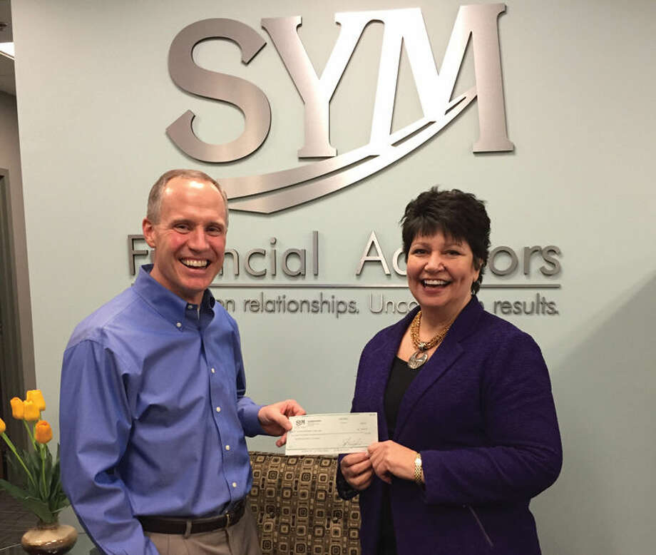 Rod Coleman, president of SYM Financial Advisors, presents a check for $2,324 to Susan Putnam, president and CEO of Big Brothers Big Sisters of the Great Lakes Bay Region. Photo: Photo Provided