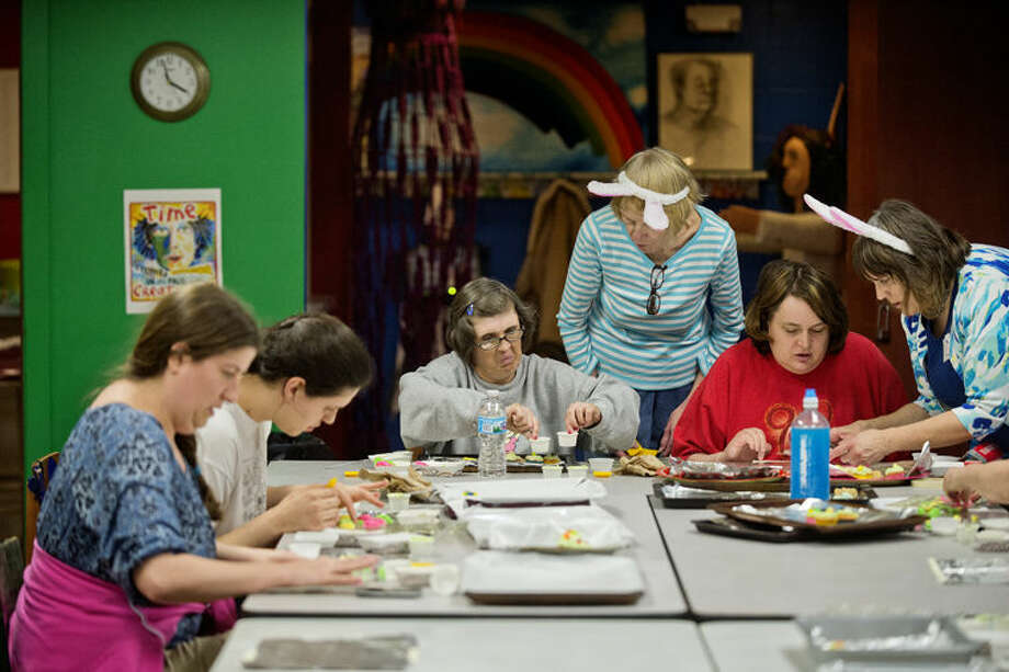Instructors Diana Bradley, standing center, and Diane Conklin, standing right, work with students during an Easter sweets candy-making class at Creative 360. Photo: Nick King/Midland Daily News