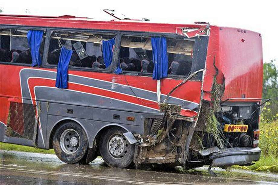 A damaged OGA Charters bus is hauled away after a fatal rollover on Saturday, south of the Dimmit-Webb County line on U.S. 83 North in Texas. Photo: Danny Zaragoza | Laredo Morning Times.