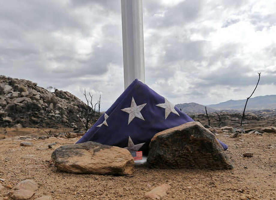 "In a Tuesday, July 23, 2013 file photo, a flag sits at the base of a flag pole at the site where 19 firefighters died battling an Arizona wildfire in Yarnell, Ariz. The producers behind a movie about the elite firefighting team that lost 19 members in a 2013 Arizona wildfire assure the story focuses on the firefighters' dedication, not the way in which they died. ""Granite Mountain"" is slated to start production Monday. Photo: Matt York 