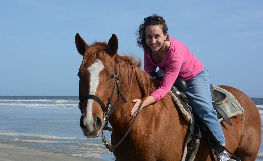 Tracie Barton-Barrett's lifelong love of animals helped her find a counseling specialty - helping others cope with grief at the loss of their treasured animal companions. Photo: Photo Provided