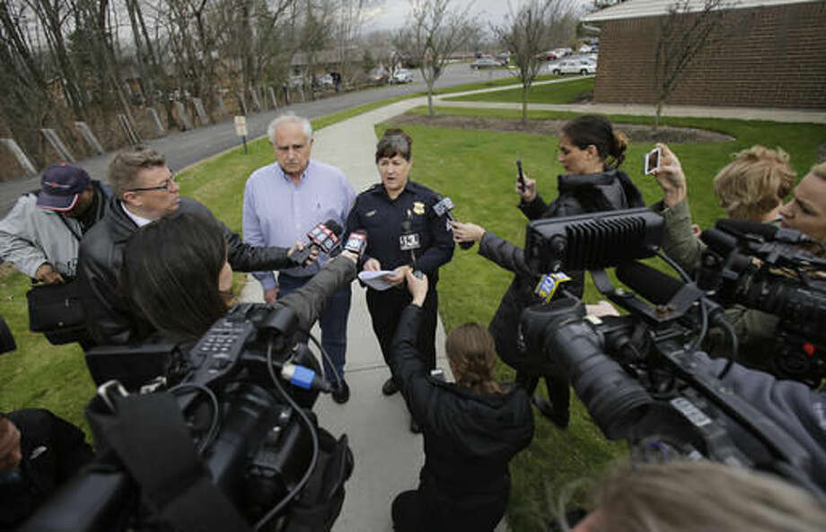Chagrin Falls Mayor Bill Tomko, left, and Chagrin Falls Sgt. Kimberely Libens answer questions at a news conference at the Hamlet Hills Village Thursday. Police say a shooting happened early Thursday in the upscale community 20 miles from Cleveland. Photo: Tony Dejak | AP Photo