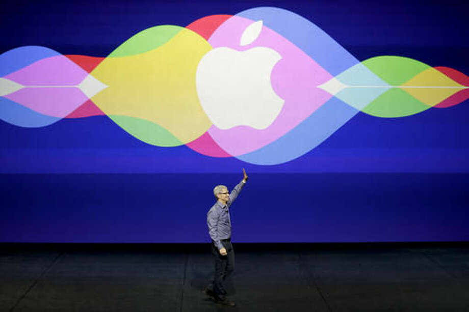 FILE - In this Wednesday, Sept. 9, 2015, file photo, Apple CEO Tim Cook waves during the Apple event at the Bill Graham Civic Auditorium in San Francisco. Apple is expected to unveil some new additions to its current family of iPhone and iPad devices at the company's product announcement on Monday, March 21, 2016. So far, however, there have been no hints of any dramatic announcements, such as 2015's highly anticipated Apple Watch debut, or major initiatives like the company's long-rumored but yet-to-materialize streaming TV service. (AP Photo/Eric Risberg, File) Photo: Eric Risberg