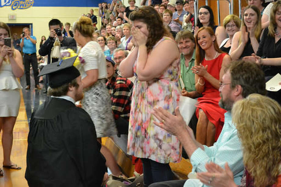 """University of Maine at Presque Isle's Timothy Babine proposes to his girlfirend, Hayley Hamilton, during commencement exercises at the school. Hamilton shook her head """"yes,"""" and Babine placed an engagement ring on her finger. The crowd cheered. Photo: Rachel Rice 
