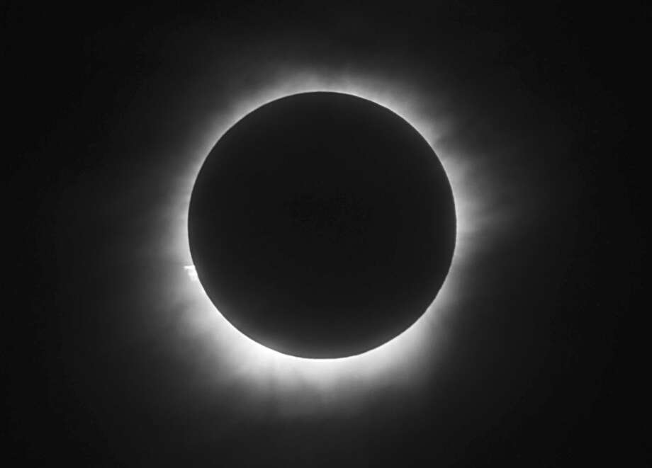 FILE - This March 9, 2016 file photo shows a total solar eclipse in Belitung, Indonesia. Hotel rooms already are going fast in Wyoming and other states along the path of next year's solar eclipse. The total solar eclipse on Aug. 21, 2017, will be the first in the mainland U.S. in almost four decades. (AP Photo, File) Photo: STR