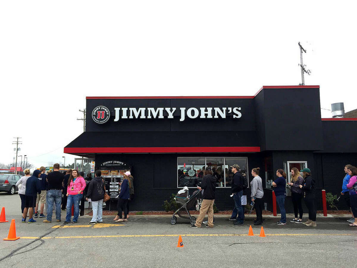 Customers wind around the Jimmy John's at 1916 S. Saginaw Road in midland Thursday afternoon. Jimmy John Liautaud started his business when he was 19 years old after graduating high school. His first menu only included four different sandwiches, according to Jimmy John's official website.