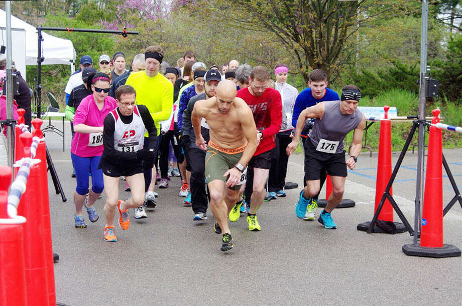 Runners on Saturday start a 5K run at Chippewa Nature Center as part of the 11th annual Arc Stroll, Roll and 5K Run. Photo: Photo Provided