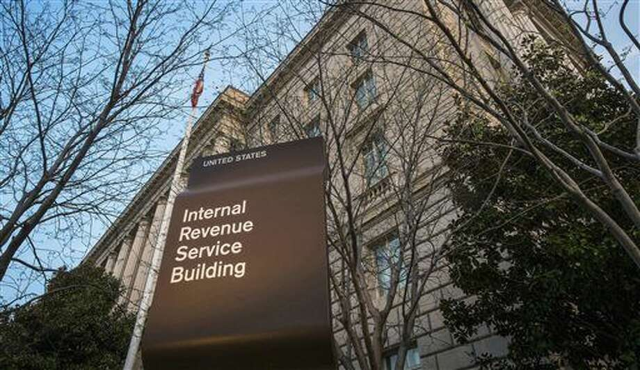 FILE - This April 13, 2014, file photo shows the Internal Revenue Service (IRS) headquarters building in Washington. Millions of taxpayers face a midnight deadline Monday, March 18, 2016, to file their tax returns, while millions of other Americans seek more time, a six-month extension. The filing deadline was delayed three days beyond the traditional April 15 deadline, because Friday was a legal holiday in the District of Columbia. (AP Photo/J. David Ake, File) Photo: J. David Ake