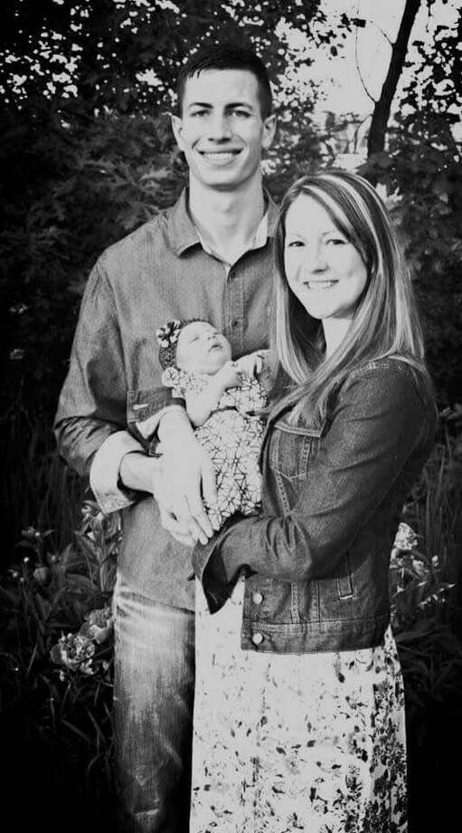 Dr. Ryan Balzer is opening ADIO Chiropractic at 301 E. Wackerly St. in the Bell Plaza. Balzer is shown with his wife, Elizabeth, and their newborn daughter, Olivia. The practice will treat the entire family. Photo: Photo Provided