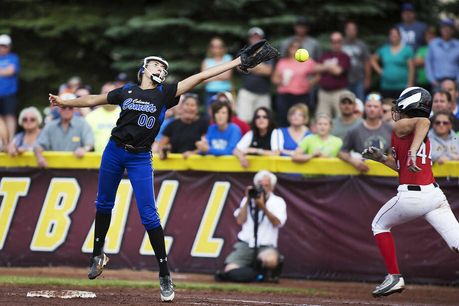 Coleman first-baseman Faith Barden, left, attempts to catch an errant throw during Tuesday's Division 4 softball quarterfinal against Holton at Central Michigan University. The Red Devils upset the top-ranked Comets 6-3. Photo: Theophil Syslo For The Daily News