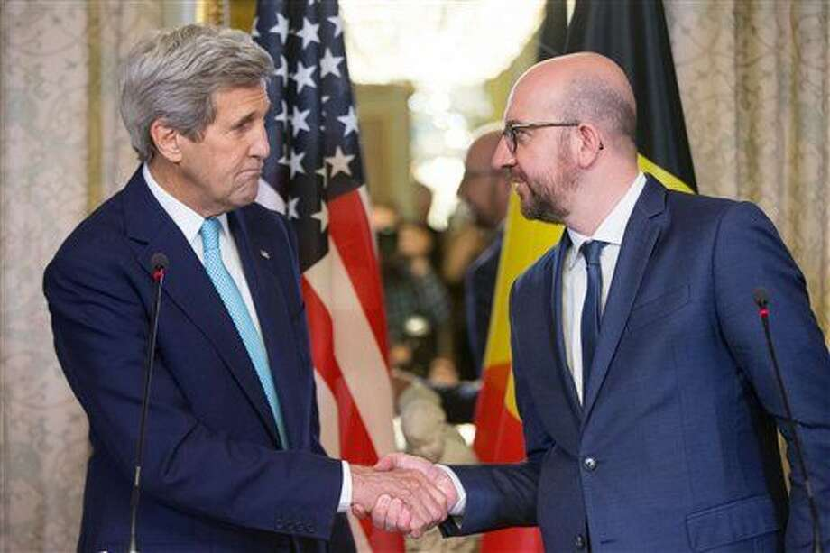 Secretary of State John Kerry shakes hands with Belgian Prime Minister Charles Michel after delivering a joint statement at the Belgian Prime Minister's Residence in Brussels, Belgium, Friday. Photo: Andrew Harnik | AP Photo, Pool