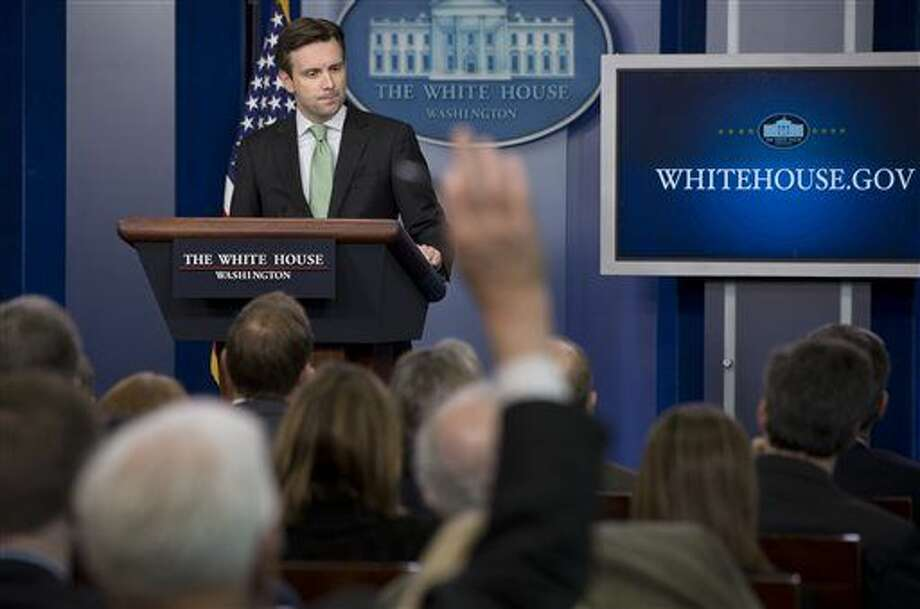 FILE - In this Dec. 17, 2014, file photo, White House press secretary Josh Earnest takes questions during the daily briefing at the White House in Washington. Trust in the news media is being eroded by perceptions of inaccuracy and bias, fueled in part by Americans' skepticism about what they read on social media. Just about 6 percent of people say they have a lot of confidence in the media, putting the news industry about equal to Congress and well below the public's view of other institutions. (AP Photo/Jacquelyn Martin, File) Photo: Jacquelyn Martin