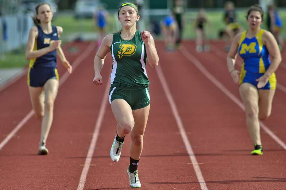 Dow High's Anna Blasy, center, competes in the 100-meter race during Monday's track meet vs. Midland High and Mount Pleasant. Photo: Nick King/Midland Daily News