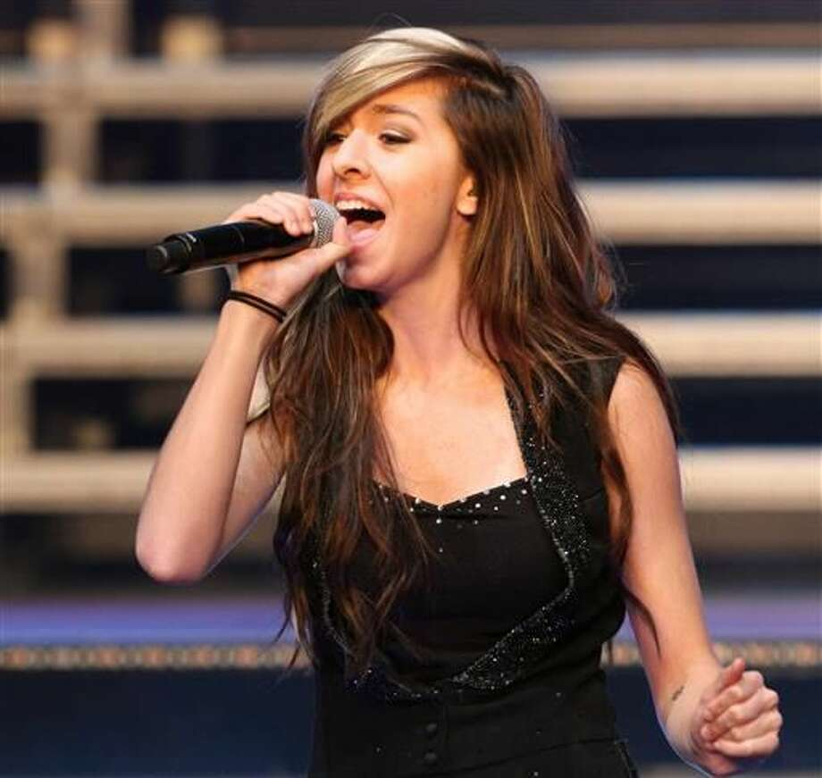 "FILE - In this June 29, 2014, file photo, ""The Voice"" Season 6 contestant Christina Grimmie performs as part of ""The Voice Tour"" at Cobb Energy Centre, in Atlanta. Family and friends gathered in New Jersey on Friday, June 17, 2016, for a viewing and memorial service to remember Grimmie, who was fatally shot a week earlier, as she signed autographs after a show in Orlando, Fla. Photo: Photo By Robb D. Cohen/Invision/AP,  File"
