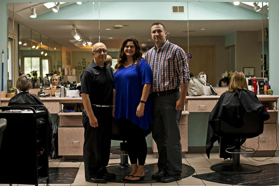 ERIN KIRKLAND | ekirkland@mdn.net From left, former owner Nathan Torres and current owners Krystal and Jeff Zienert pose for a photo on Wednesday at Nathan's Hair Unlimited. The salon celebrated its 40th anniversary. Photo: Erin Kirkland/Midland Daily News