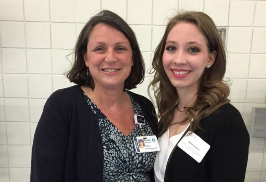 Pictured is scholarship recipient Robin Shisler with Diana Brookens, manager of volunteers for MidMichigan Health. Shisler is currently in her second year of a four-year program at University of Michigan - Flint in the doctor of nursing practice program.