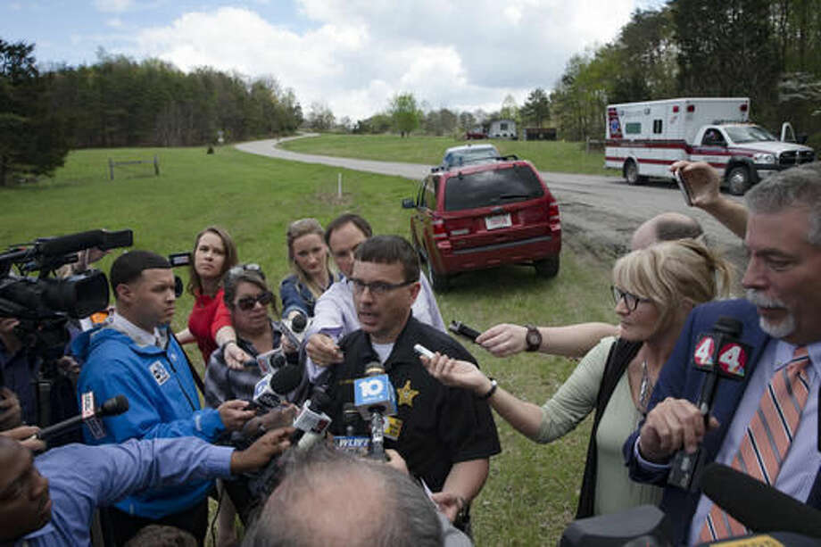 Lt. Michael Preston, of the Ross County Sheriff's Department speaks to the media on Union Hill Road that approaches a crime scene, Friday, April 22, 2016, in Pike County, Ohio. Shootings with multiple fatalities were reported along the road in rural Ohio on Friday morning, but details on the number of deaths and the whereabouts of the suspect or suspects weren't immediately clear. The attorney general's office said a dozen Bureau of Criminal Investigation agents had been called to Pike County, an economically struggling area in the Appalachian region some 80 miles east of Cincinnati. Photo: AP Photo/John Minchillo