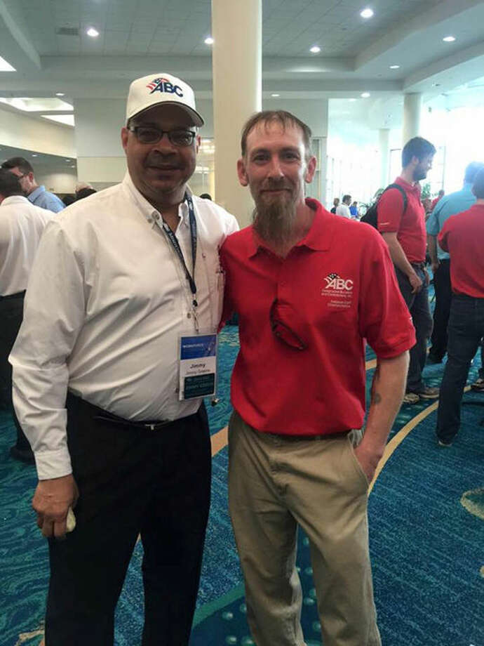 Greater Michigan Construction Academy CEO Jimmy Greene, left, and Daniel Reinig at the recent National Craft Championships in Fort Lauderdale, Fla. Reinig was entered in the electrical-residential/commercial category. Photo: Photo Provided