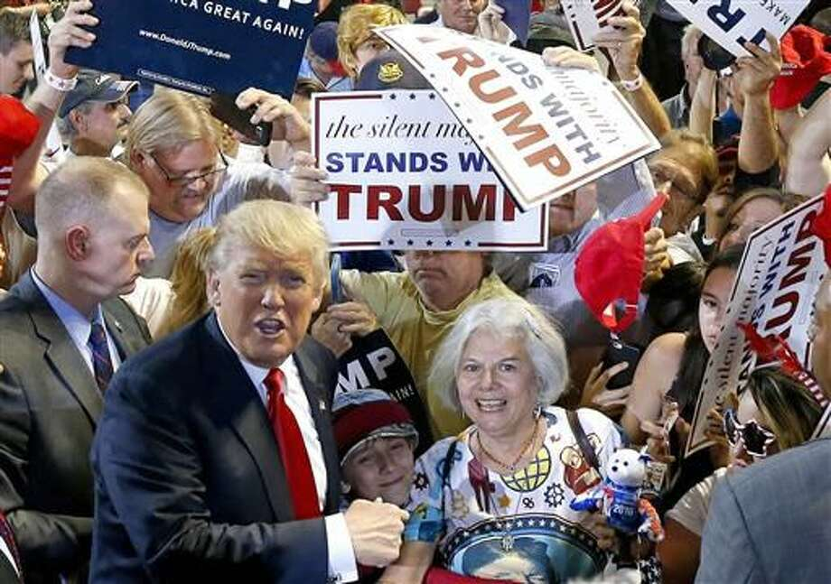 Republican presidential candidate Donald Trump, left, shouts to Secret Service agents that supporter Diana Brest, right, had been waiting in line since 2 a.m. to see the candidate speak at a rally Saturday, June 18, 2016, in Phoenix. Photo: AP Photo/Ross D. Franklin