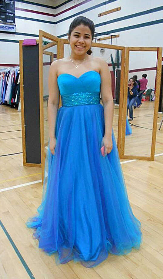 A local teen finds her dream dress during this year's Share the Memories event. Photo: Photo Provided