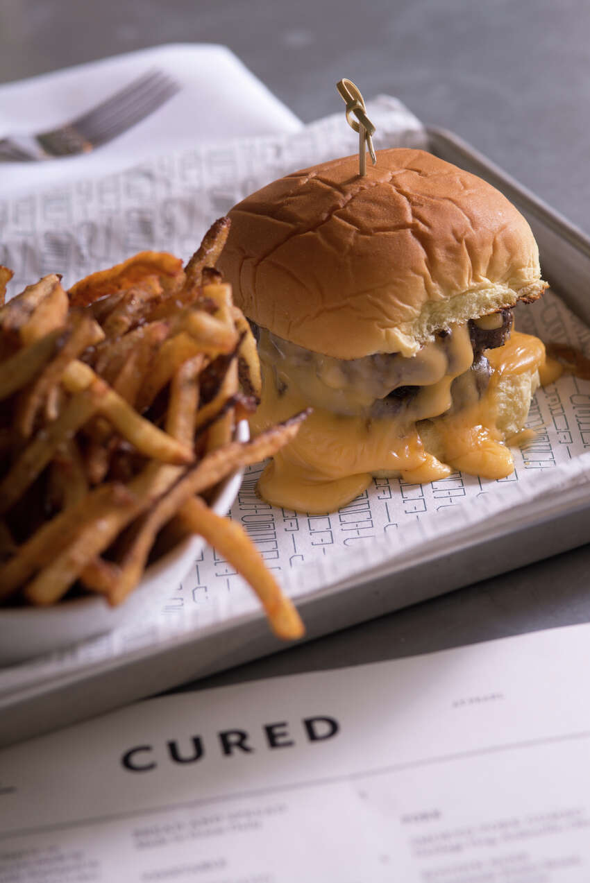 A double Blue Ribbon burger from Cured at the Pearl.