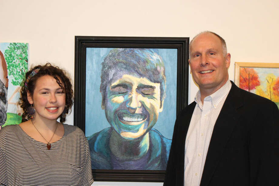 """Congressman John Moolenaar is shown with H.H. Dow High School student Natalie Laurin at the Midland Center for the Arts. Laurin's acrylic painting, """"Caleb,"""" was chosen as winner of the 2016 Congressional Art Competition for Michigan's Fourth Congressional District. Photo: Photo Provided"""