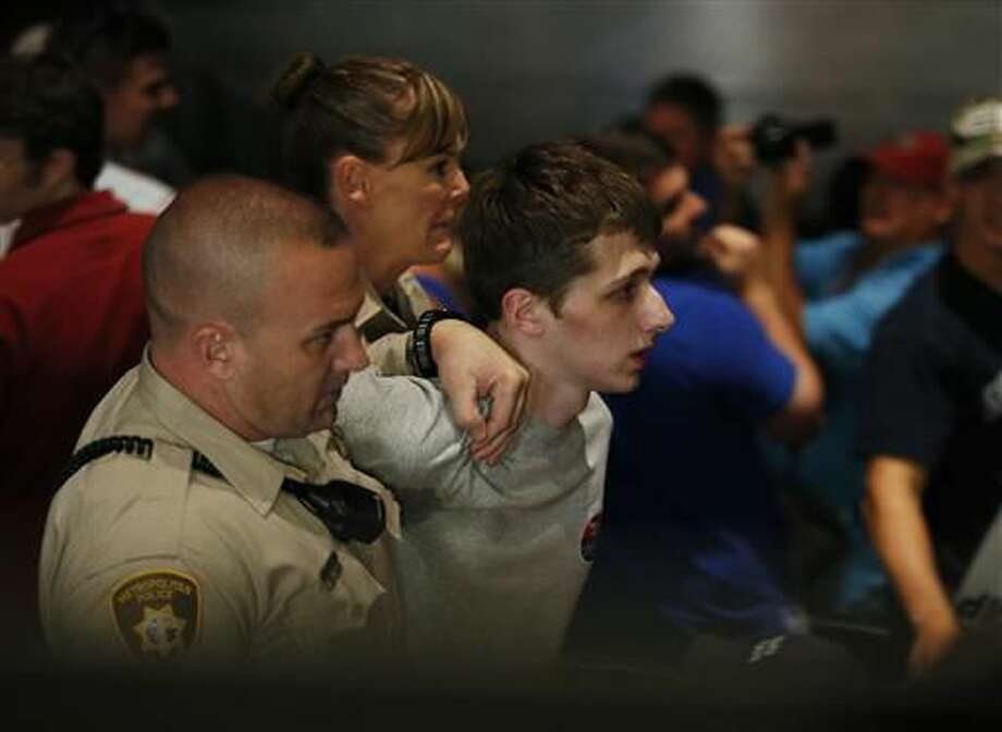 Police remove protestor Michael Steven Sandford as Republican presidential candidate Donald Trump speaks at the Treasure Island hotel and casino in Las Vegas. Sandford, a British man, is accused of trying to take a police officer's gun and kill Donald Trump during a weekend rally in Las Vegas. Photo: AP Photo